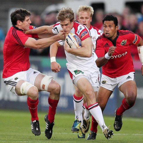 Ulster winger Andrew Trimble is tackled by Munster's David O'Callaghan
