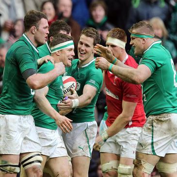 Brian O'Driscoll is congratulated after scoring Ireland's third try