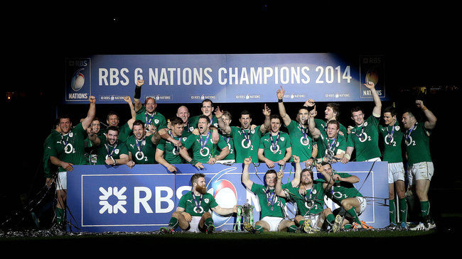 The victorious Ireland players celebrate with the Six Nations trophy