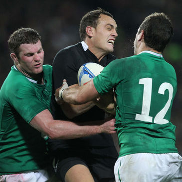 Donnacha Ryan and Paddy Wallace tackle New Zealand's Israel Dagg