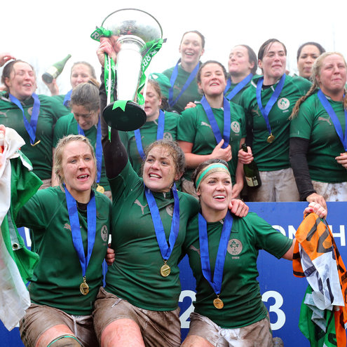 Fiona Coghlan lifts the trophy as her team-mates celebrate