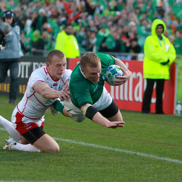 Keith Earls dives over in the left corner to score his first try