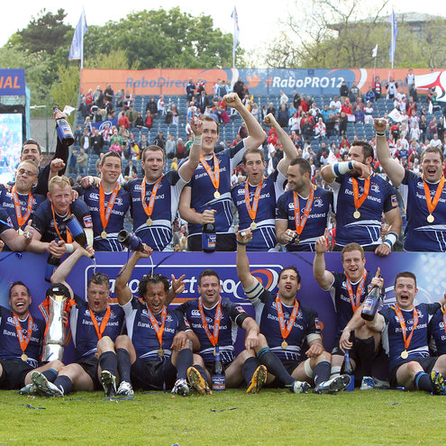 The Leinster players celebrate with the league trophy