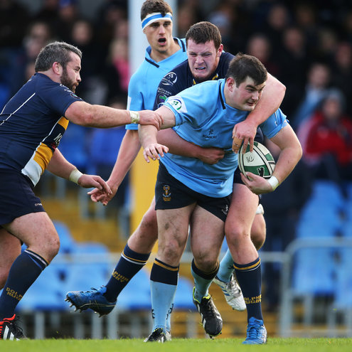 UCD try scorer Rory Harrison takes the ball on