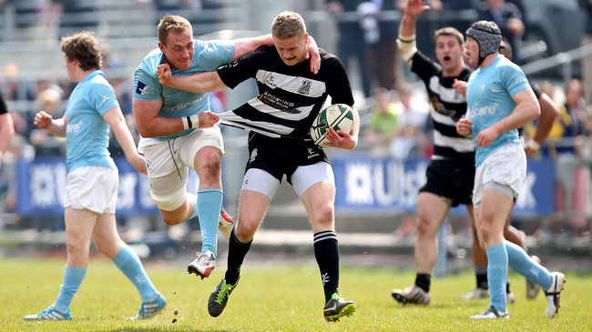 Garryowen's Shane Buckley tackles Old Belvedere out-half Steve Crosie