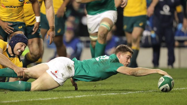 Garry Ringrose reaches over for his first international try