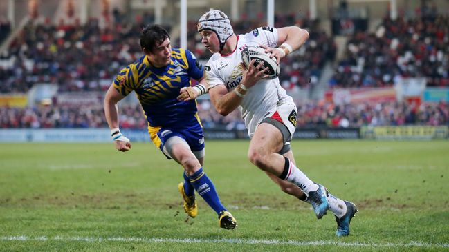 Centre Luke Marshall runs in a try for Ulster