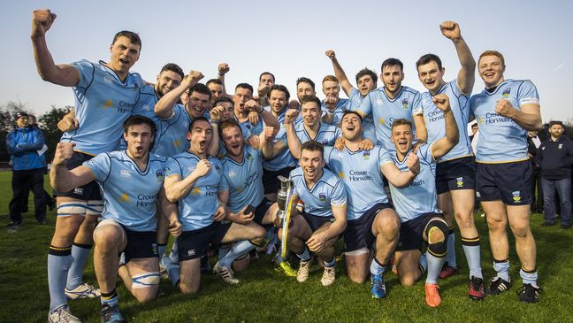 UCD captain Jamie Glynn and his team-mates celebrate with the trophy