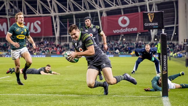 Jacob Stockdale dives over to score Ireland's fourth try of the night
