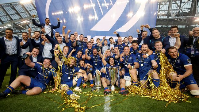 The Leinster players celebrate with both trophies