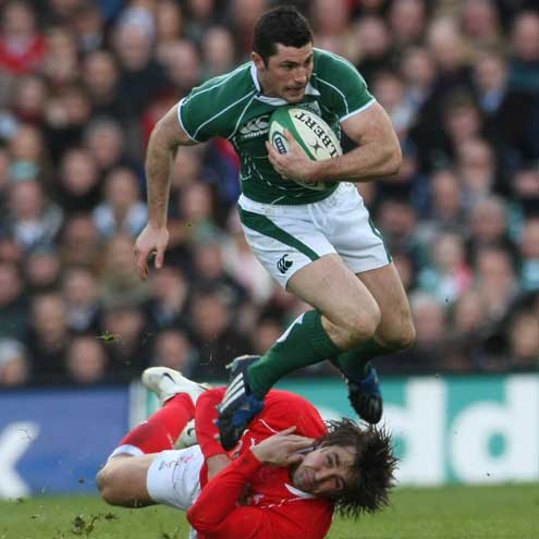 Rob Kearney gets past a tackle from Wales' Gavin Henson