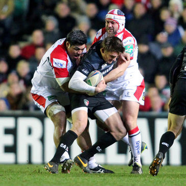 Nick Williams and Rory Best tackle Toby Flood