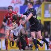 Llanelli's Gavin Evans carries the ball forward under pressure from Leinster flanker Stephen Keogh