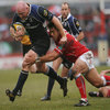 Bernard Jackman, Leinster's Ireland-capped hooker, is tackled by Llanelli prop Mahonri Schwalger