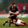 Llanelli front rower Bruce Douglas gets across to halt the progress of Leinster lock Malcolm O'Kelly