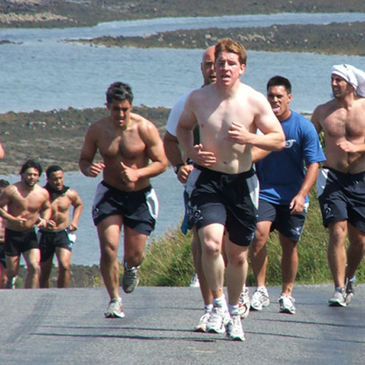 Aidan Wynne leads the Connacht players on a hill run