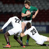 Bustling centre Brendan Macken holds up possession as he is challenged by two English players