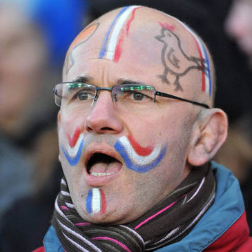 A French fan proudly displays his colours