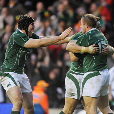 Stephen Ferris and David Wallace congratulate Jamie Heaslip on his try