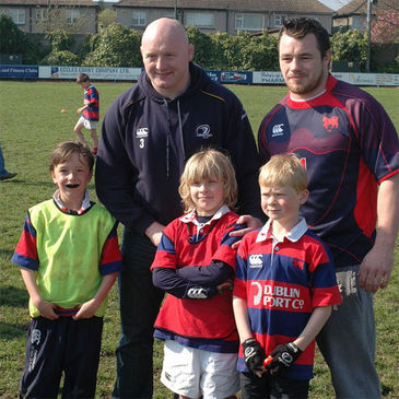 Bernard Jackman and Cian Healy with some of Clontarf's Mini rugby stars