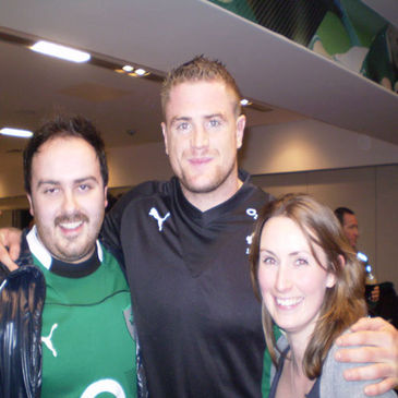 Draw winner Louise O'Leary and Graham Vard chatting with Ireland's Jamie Heaslip