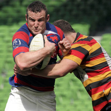 Clontarf hooker Aaron Dundon is tackled by Lansdowne's Charie Butterworth