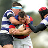 Leinster hooker Aaron Dundon lined out for Clontarf. He is pictured above being tackled by Blackrock's Jack O'Beirne and Alex Dunlop