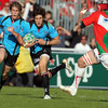Heineken Cup debutant Adam D'Arcy tries to break away from Biarritz's covering flanker Magnus Lund