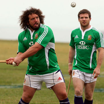 Adam Jones practises his hurling skills alongside Gordon D'Arcy
