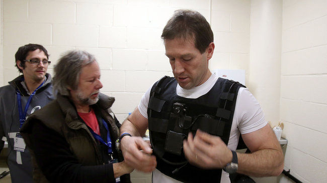 Alain Rolland gets fitted with the ref cam vest