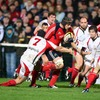 Ulster flanker David Pollock gets across to tackle Munster's Alan Quinlan as he threatens