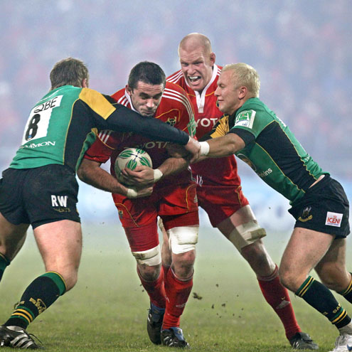 Munster's Alan Quinlan takes the ball into contact against Northampton