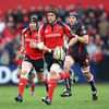 Alan Quinlan, one of eight Munstermen named in the 2009 Lions squad, leads a counter-attack for the province against the Scarlets
