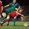 Munster flanker Niall Ronan is tackled by Connacht's Andrew Browne as he tries to collect a loose ball