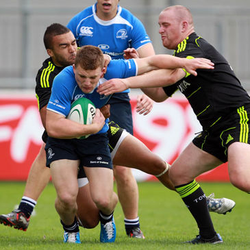 Leinster winger Andrew Conway is tackled by Munster's Simon Zebo and Sean Henry