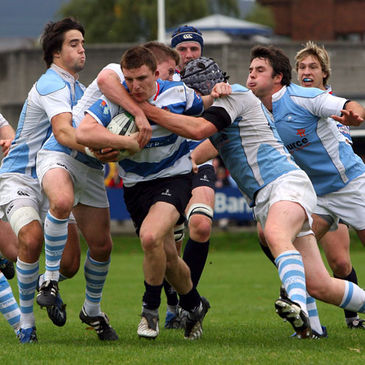 Blackrock full-back Andrew Conway is tackled by the Garryowen cover