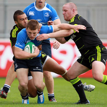 Munster's Simon Zebo and Sean Henry tackle Leinster winger Andrew Conway