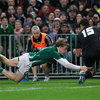 Andrew Trimble dives for the try-line, with New Zealand full-back Israel Dagg making a last-ditch challenge