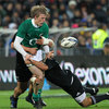 Under pressure from two tacklers, Andrew Trimble, one of Ireland's best performers on the day, manages to get his pass away