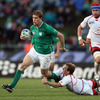 Andrew Trimble, who was also making his first start of the 2011 World Cup, is pictured trying to break away from Russian scrum half and captain Alexander Yanyushkin