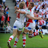 Chris Henry celebrates with try-scoring winger Andrew Trimble. The conversion from Ian Humphreys made it 13-7 to Ulster