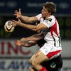 Ulster's Andrew Trimble and Dragons wide man Gareth Wyatt compete for possession