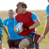 The in-form Andrew Trimble races forward with ball in hand during a training game at the Queenstown facility