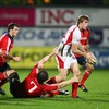 Ulster winger Andrew Trimble prepares to offload ahead of a diving John O'Sullivan