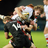Ulster try scorer Andrew Trimble feels the force of a double tackle from Edinburgh's Mark Robertson and Roddy Grant