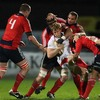 Ulster winger Andrew Trimble is swallowed up by the Munster defence