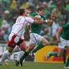 Andrew Trimble stretches his legs as he looks to outstrip Russia's Vladimir Ostroushko during a rain-hit first half