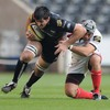Ulster flanker Kieron Dawson goes low to try and stop Andy Lloyd of the Ospreys