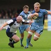 Leinster hooker Bernard Jackman lunges as he tries to stop a run from Cardiff's Andy Powell