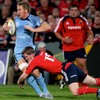 Cardiff back rower Andy Powell is tackled in possession by Munster's Denis Hurley